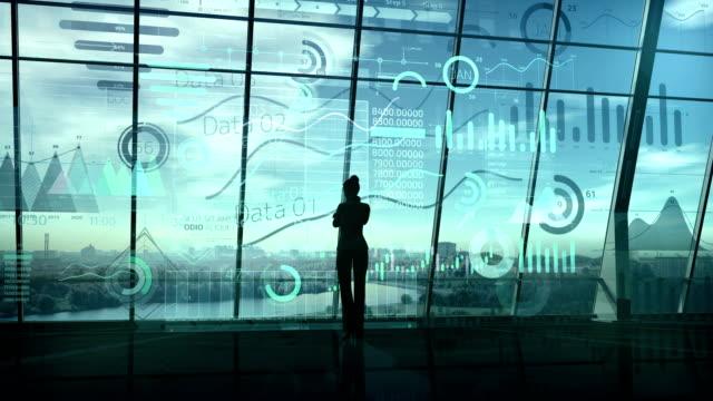 vídeos de stock e filmes b-roll de silhouette of a business woman surrounded by an array of data. - atuação