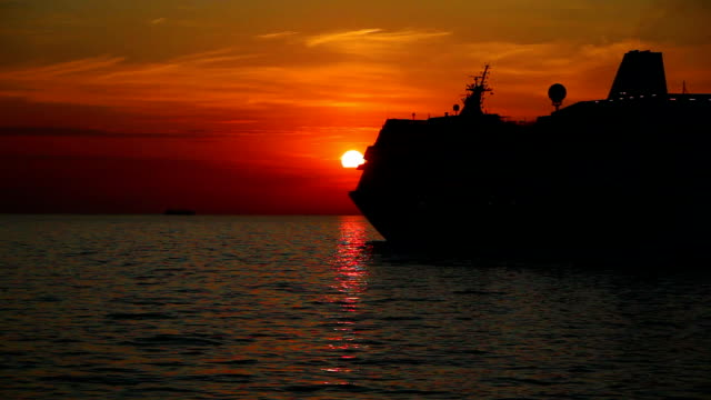 silhouette of a cruise liner at sunset