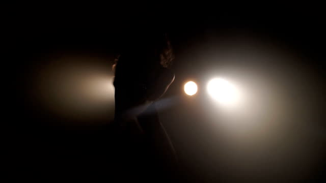 Silhouette of a girl dancing on the background lights Silhouette of a girl dancing on the background lights. leotard stock videos & royalty-free footage