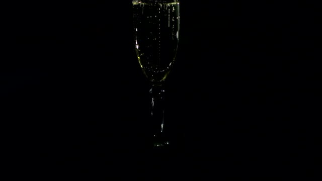 Silhouette of a glass of champagne in the dark. video