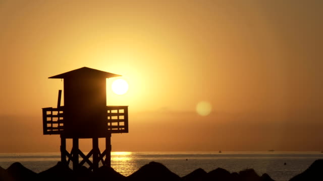 Silhouette of a lifeguard tower on the beach video