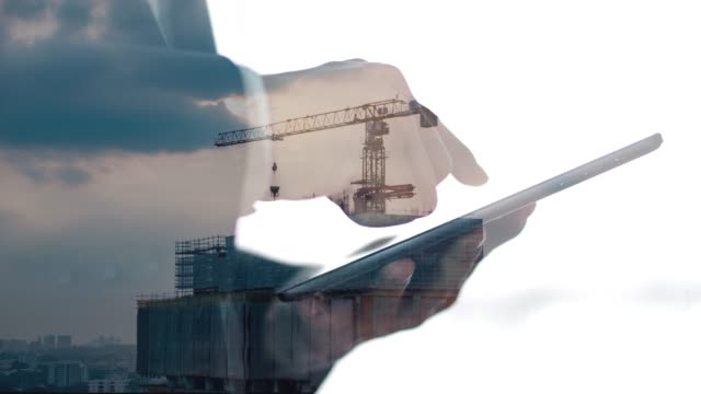 silhouette of a man and digital tablet - tułów filmów i materiałów b-roll