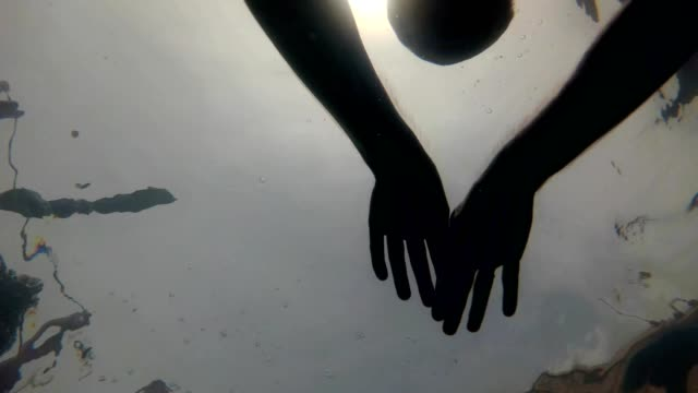 Silhouette Of A Man In Swimming Pool Underwater video