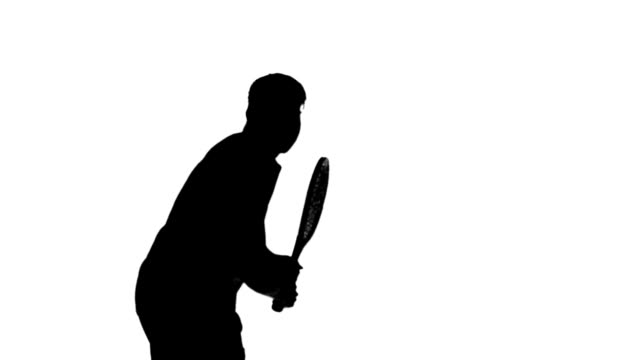 Silhouette of a man playing tennis on white background video