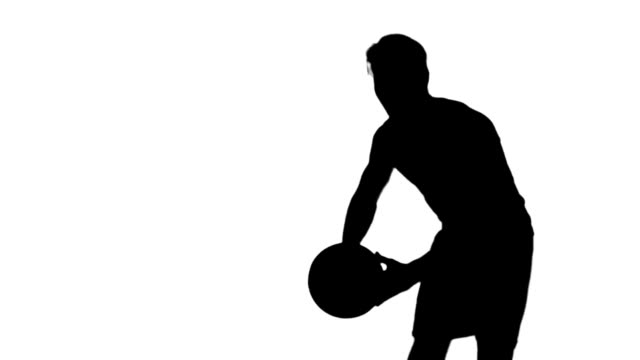 Silhouette of a man throwing a basketball video