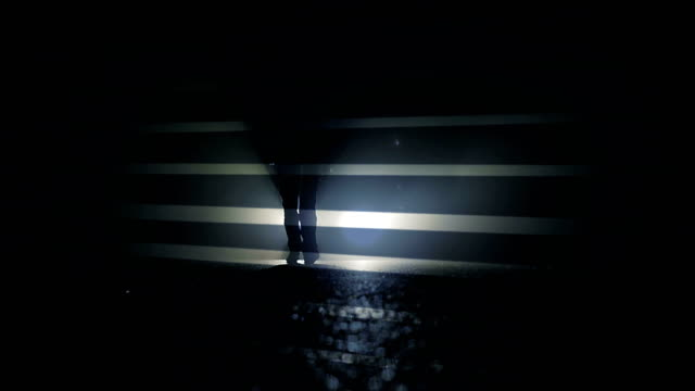 Silhouette of a Mysterious Person Standing in Front of Headlights. video