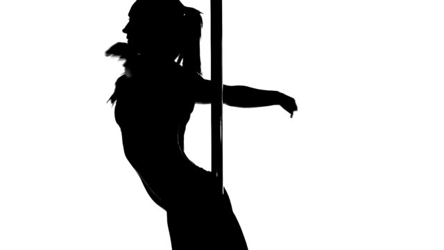 Silhouette of a sexy female pole dancing video