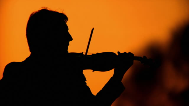 HD: Silhouette Of A Violinist At Sunset video