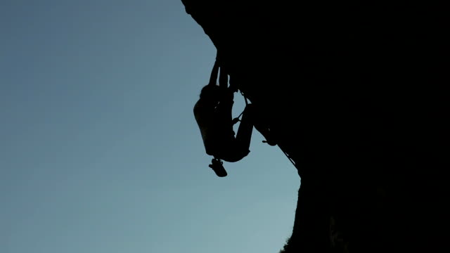 Silhouette of a woman climber video