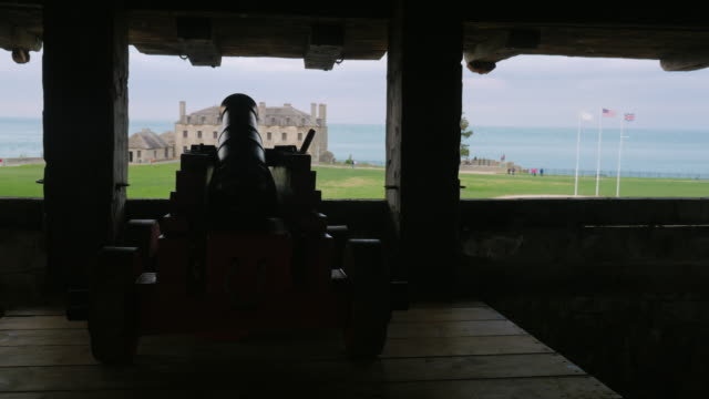 Silhouette of an old cannon at Fort Niagara. Its trunk looks at trees video