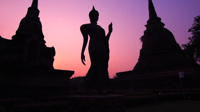 Silhouette of Ancient Ruins Against Colorful Sky, Sukhothai, Thailand video