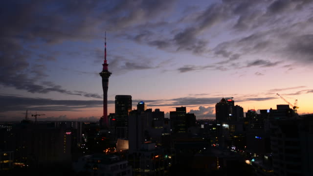Silhouette of Auckland skyline at sunrise video