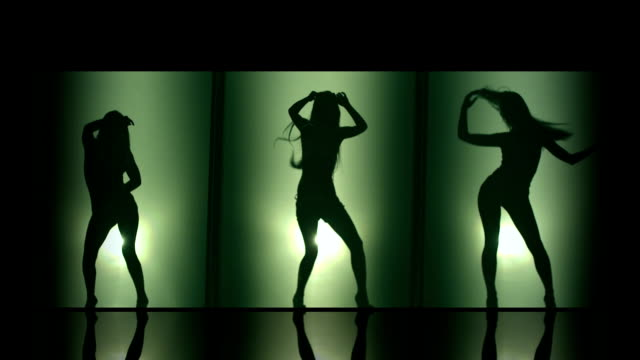 A silhouette of beautiful girls woman dancing elements. Against colored & gray background.