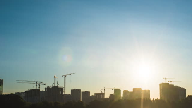 Silhouette of construction site and city skyline in the morning