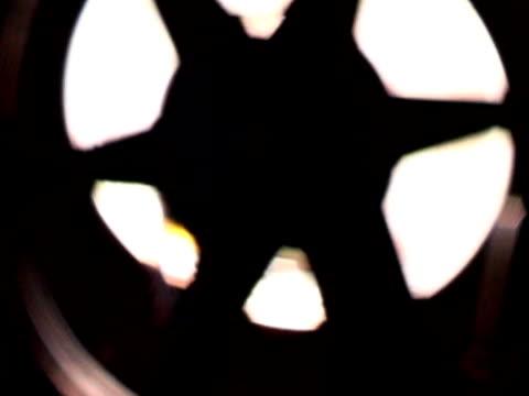Silhouette of film projector reel video