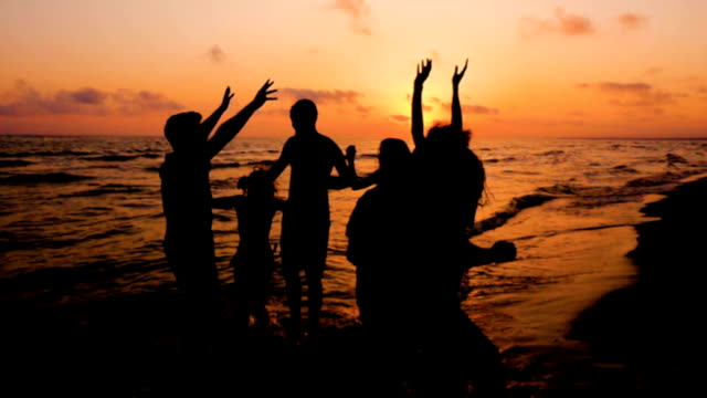 Silhouette Of four Friends Dancing On Ocean Beach At Sunset Silhouette Of four Friends Dancing On Ocean Beach At Sunset beach party stock videos & royalty-free footage