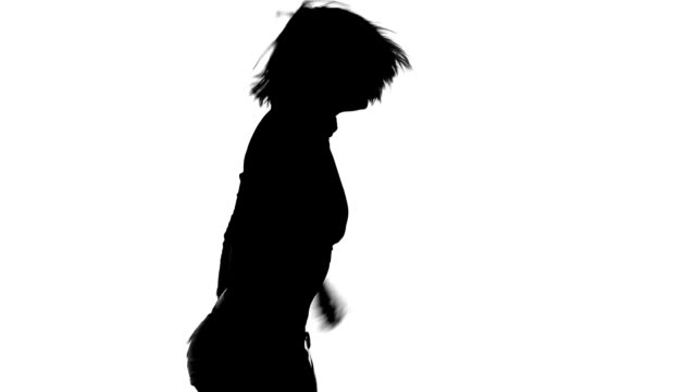 Silhouette of girl dancing energetically on a white background video