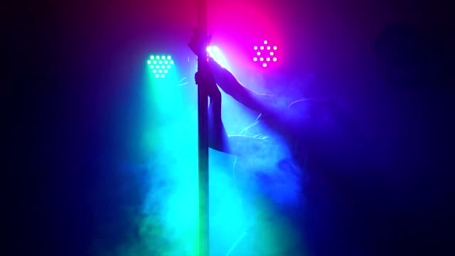 silhouette of girl with long hair dancing on pole. - asta oggetto creato dall'uomo video stock e b–roll