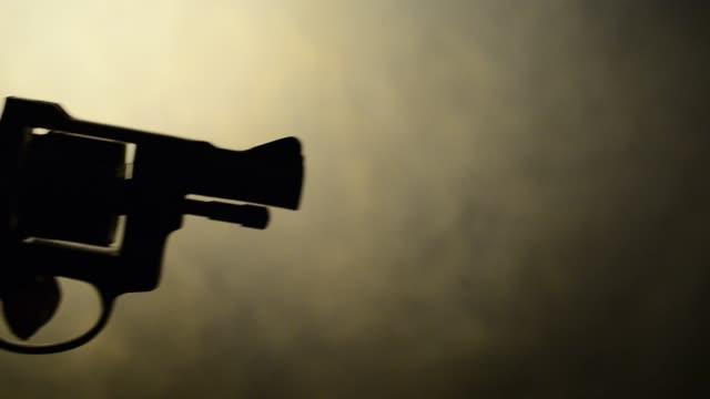 silhouette of handgun studio light sepia toned stock videos & royalty-free footage