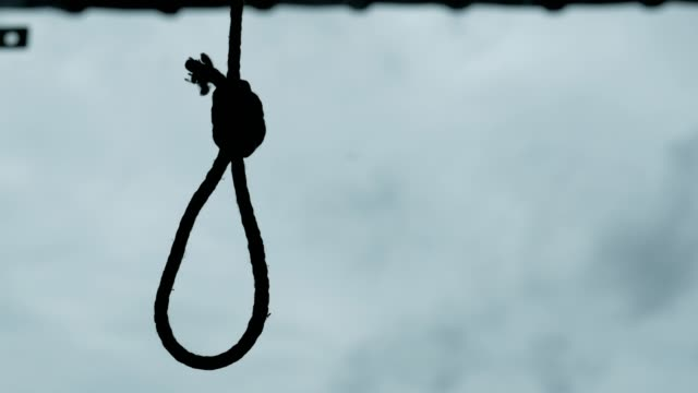 Silhouette of Hangman's noose knot. commit suicide concept.