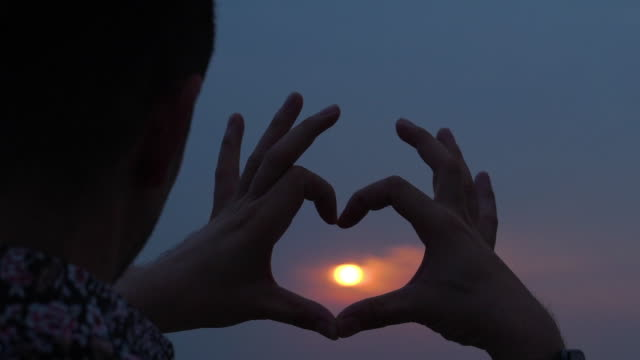 silhouette of Heart Sign by mature man