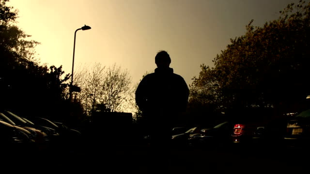 Silhouette of man approaching.