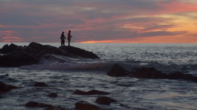 silhouette of man fishing on the rock of sea from at sunset silhouette of man fishing on the rock of sea from at sunset connecticut stock videos & royalty-free footage