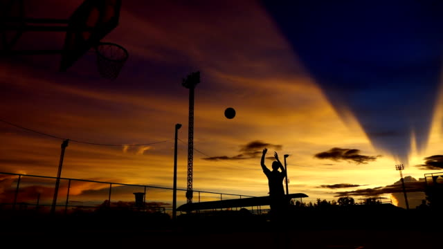 Silhouette of man playing basketball,Slow motion video