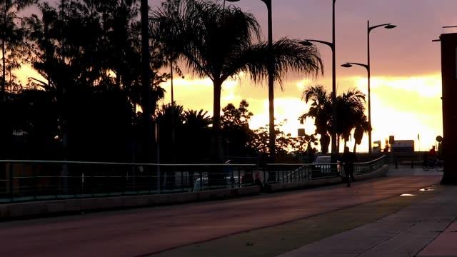Silhouette of man running on athletics trackat sunrise in Las Palmas city, Gran Canaria