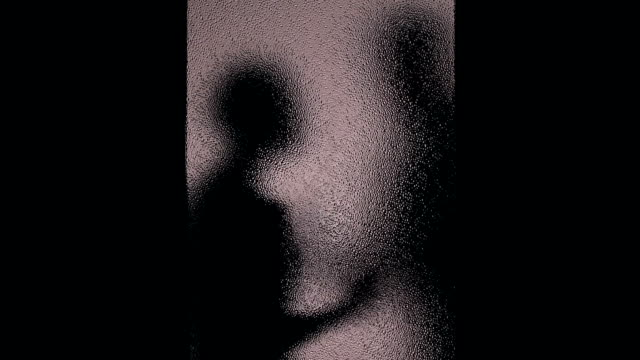 Silhouette of man slapping woman behind closed door, harassment in family