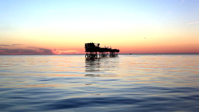 Silhouette of offshore oil platform at sunset video