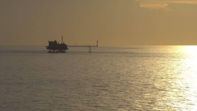 Silhouette of offshore oil production platform video