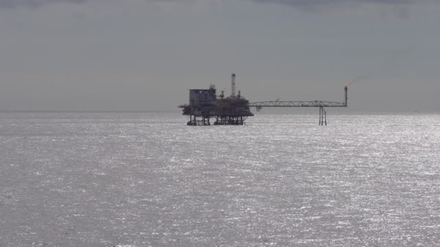 silhouette of oil platform in the ocean video