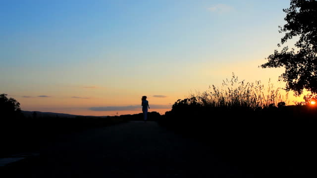 Silhouette of running woman. video