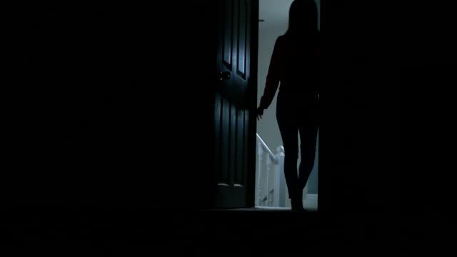 silhouette of slim young female entering a dark room. - fruktan bildbanksvideor och videomaterial från bakom kulisserna