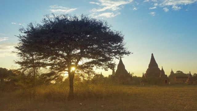 Silhouette of Temples and tree in Bagan at sunset Silhouette of Temples and tree in Bagan at sunset, Myanmar (Burma), slider dolly shot 4k bagan stock videos & royalty-free footage