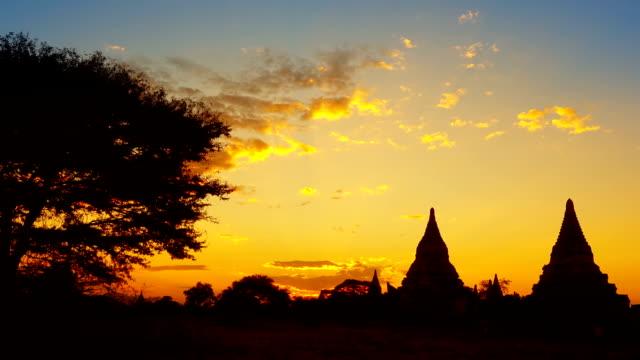 Silhouette of Temples and tree in Bagan at sunset Silhouette of Temples and tree in Bagan at sunset, Myanmar (Burma), zoom timelapse bagan stock videos & royalty-free footage
