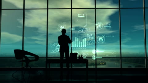 silhouette dell'uomo in ufficio e infografica aziendale - concetti e temi video stock e b–roll