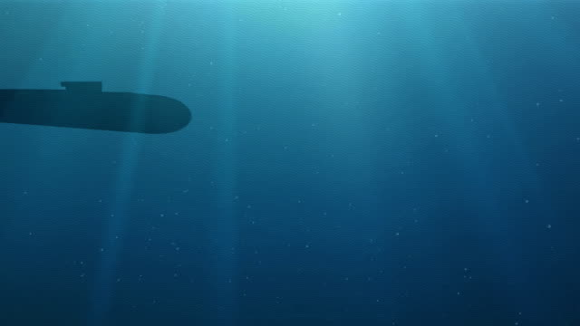 Silhouette of the submarine floats in a deep water