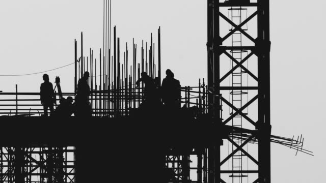 silhouette of workers at construction site - black and white architecture stock videos & royalty-free footage