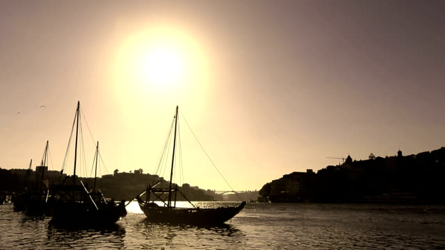VDO :Silhouette old Porto and traditional boats, Portugal