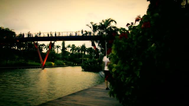 Silhouette People On The Bridge