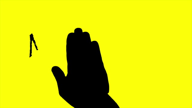 Silhouette persons hand over marketing Writing animation yellow background A silhouette persons hand over internet marketing Writing animation on yellow background. Animation marketing writing banner with a silhouette persons hand slowly moves over the golden paper. homepage stock videos & royalty-free footage