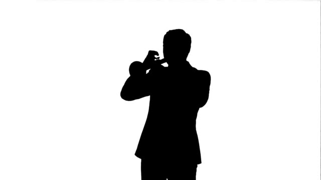 Silhouette Portrait of a young man playing his Trumpet video