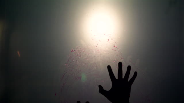 Silhouette scared of red blood hand