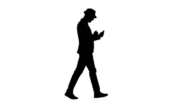 Silhouette Serious arabic casual man using smartphone while walking