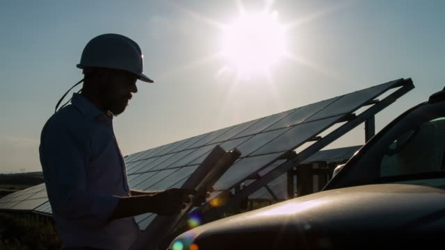 Silhouette Technician At Solar Power Station video