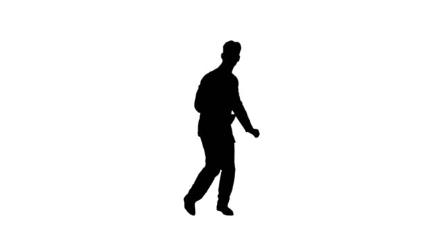 Silhouette Very cool young dancing businessman