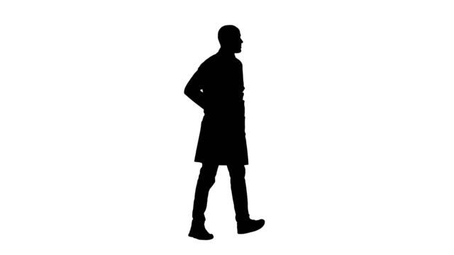 Silhouette Walking doctor in a robe