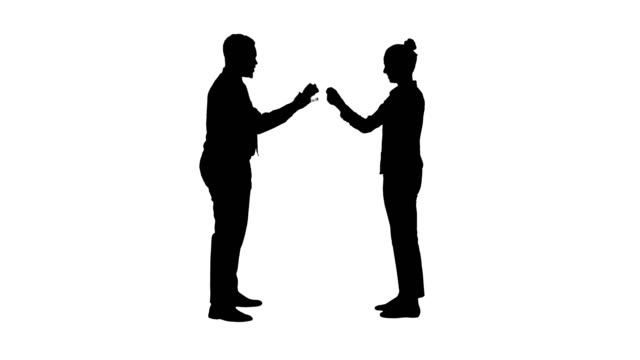 silhouette woman and man doign the paper, scissors, rock game - forbici video stock e b–roll